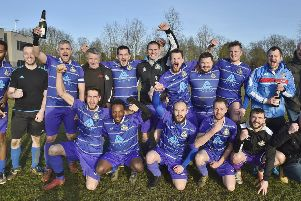 Peterborough NECI celebrate their Peterborough Division Three title success. Photo: David Lowndes.