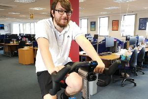 Contact Centre agent Dan Miller keeps pedalling.