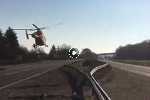 The Magpas air ambulance taking off from the A1 at Little Paxton