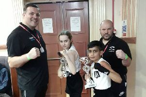 Pictured at a show in Leicester on Sunday are from the left coach, Leighton Morgan , boxers Emily Anderson and Rushaan Raja and coach Mark Dane.