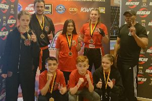 TASK fighters with chief instructor Rob Taylor. From the left are, back, Emilia SkupiDska, Richard Atkinson, Jazmyn Popat-Evans, Lucy Stirland, Rob Taylor, front, Taylor Popat-Evans, Braydon Popat-Evans and Skaiste Stukaite.