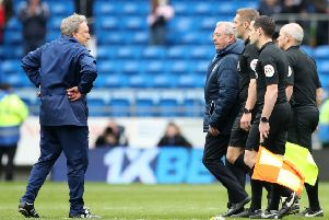 Cardiff City manager Neil Warnock and some dozy officials.