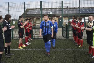 Pedterborough Premier Division champions Moulton Harrox are given a guard of honour by Nethertton United players and match officials. Photo: David Lowndes.