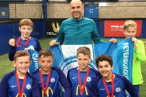 The victorious Posh Deaf Under 13 team. From the left are, back, Joe Treacey, John Martins (Coach), Daniel Monaf, front, William Barnsley, Finley McEwan, Alex Hannan and Simao Martins.