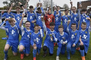Spalding United Blue Under 13s celebrate their League Cup success.
