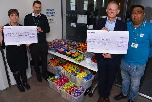 Cheques totalling �3,000 are being handed over to local good causes
