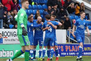 Posh players celebrate Matt Godden's goal against Gillingham. Photo: Joe Dent/theposh.com.
