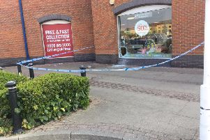 Police tape around the BHF store at the Rivergate Shopping Centre