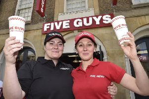 Martina Sebkova and  Roza Nieliedzial at the opening of Five Guys in Church Street, Peterborough EMN-190306-160520009