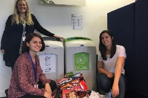 Lee Hitchborn, Julia Marques-Pike and Gabriella Brown with a week's worth of crisp packets collected for recycling.