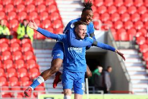 George Cooper celebrates a goal at Doncaster last season.