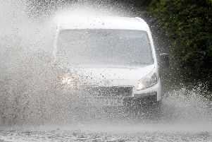 Cars make their way through standing water on the A47 near Peterborough after heavy rain fell throughout the country. Picture: Joe Giddens/PA Wire