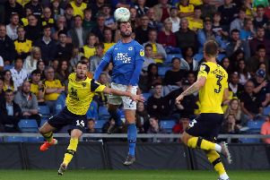 Jason Naismith of Peterborough United out jumps Anthony Forde of Oxford United. Photo: Joe Dent/theposh.com