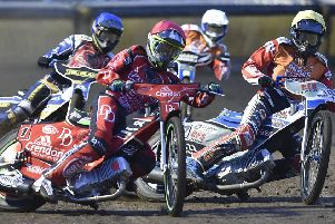 Charles Wright (red helmet) in heat one action from Panthers v Swindon. Photo: David Lowndes.