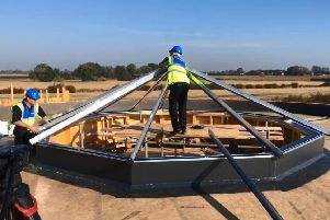 Work on the fragile glass dome