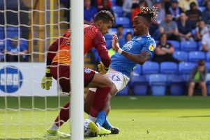 Posh striker Ivan Toney bundles home the first goal against Rochdale. Photo: Joe Dent/theposh.com.