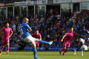 Marcus Maddison converts a penalty for Posh against Rochdale. Photo: Joe Dent/theposh.com.