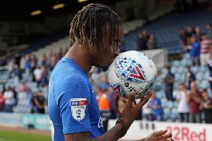 Hat-trick hero Ivan Toney with the matchball after the game.