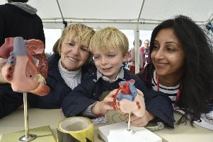 Anne Scofield and son Patrick (5) with Raj Darar looking at heart models. EMN-190928-181729009
