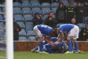 Posh striker Mo Eisa is mobbed by teammates after equalising in the 95th minute against Coventry. Photo: Joe Dent/theposh.com.