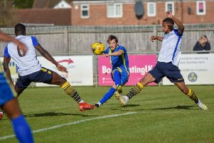 Peterborough Sports (blue) in action.