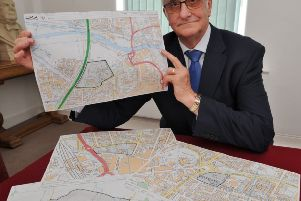 PCC council leader John Holdich with maps of proposed sites for the Peterborough University Campus sites in and around the city EMN-170530-145956009
