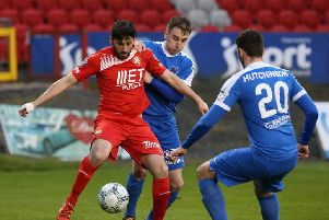 Portadown's Sean Mackle holds off Ballinamallard's Ryan McConnell at Shamrock Park, Portadown.  (Photo by David Maginnis/Pacemaker Press)