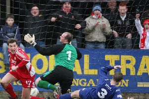 Kyle Neill celebrates during his previous spell with Portadown.