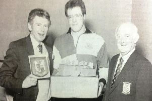 Portadown club captain Danny Forsythe made his farewell appearance for the first fifteen in 1988. After the match he was presented with awards to mark his 12 years at the club. He is pictured with Bobby McKinney and Ken Irwin
