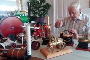 Brian Mehaffey with some of his steam-powered items
