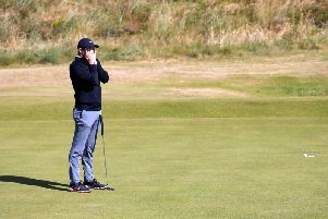 Rory McIlroy reacts to a missed putt during his second round