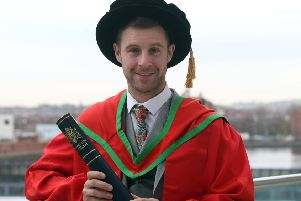 Jonathan Rea with his honorary degree from the University of Ulster at Belfast's Waterfront Hall