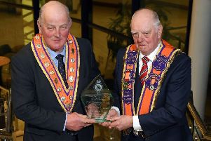 Sidney McIldoon (right) receives the Grand Master's lifetime achievement award from senior Orangeman, Edward Stevenson.