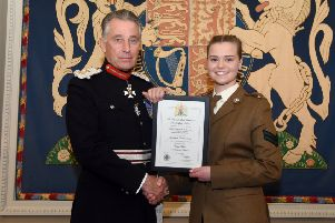 Rebecca is pictured receiving the certificate which marks her award from The Earl of Caledon, Her Majesty's Lord Lieutenant for the County of Armagh.