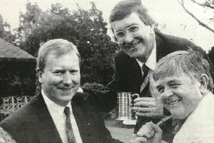 Robin Gill won Portadown Rotary Club's Harry Lauder trophy in 1993. He was presented with the trophy by Clive Henning and Bryan Mortimer