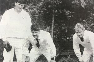 Tony Bell, Malcolm Bell and David Armstrong assess the lie of the land during a bowls match in 1993