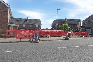 Virgin Media contractors carrying out work on Tuesday lunchtime at Gilpins Mews off the Old Portadown Road, Lurgan