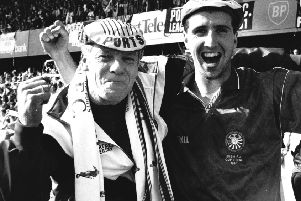 The late George Richardson (left), a long-serving Portadown kitman, celebrating trophy success with Philip Major in 1991.