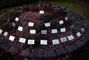 The central feature in the Garden of Remembrance at Sloan's House with individual named plaques for each of the 68 murdered brethren.