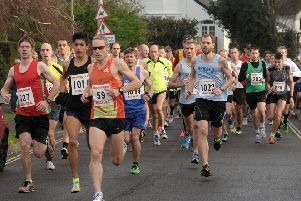 James Baker, number 59, claimed victory in the Hayling 10-mile run. Picture: Mick Young 143349-03