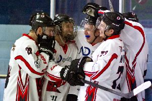 Devils celebrate scoring against Raiders