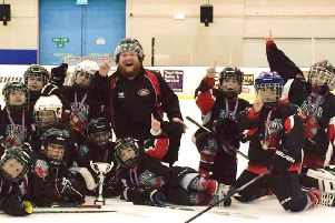 The jubilant Solent & Gosport Devils' Dragons team celebrates victory in the Swindon Hockey Academy under-nine tournament