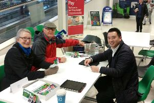 Alan Mak with residents at a drop-in supermarket advice surgery