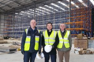 Alan Mak, centre, with chief executive Anthony Thompson and infrastructure director Simon Ratcliffe from FatFace at Dunsbury Park''CAPTION: Alan Mak, centre, at the Dunsbury Park development site.