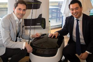 Alan Mak, right, with Henry Harris-Burland from Starship Technologies