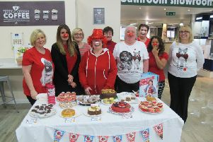 Cake-baking and beard-shaving Covers staff raise funds for Comic Relief