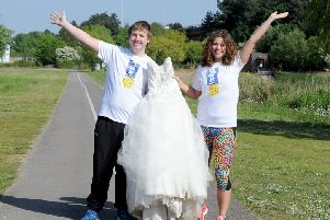 Dan and Lucy Dorey-Robinson 'are running 12 races for Cancer Research UK in their wedding gear. Picture: Sarah Standing (170589-1266) PPP-171005-133758001