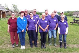 Employees from Pfizer with Sue Webber, left, from Butser Ancient Farm