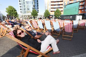 Katrina Arens and David Ellis enjoy the America's Cup action on the big screen at Gunwharf Quays