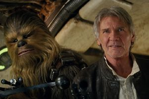 Chewbacca (Peter Mayhew) and Han Solo (Harrison Ford) Film Frame''�Lucasfilm 2015